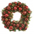 Loaded Christmas wreath isolated on white — Stock Photo
