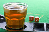 Drink on craps table — Stock Photo