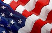 Americká vlajka mávání ve větru — Stock fotografie