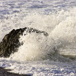 Splash from waves on rock — Stock Photo