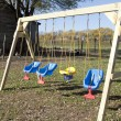 Stock Photo: Swing set on the playground