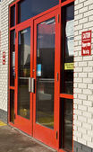 Red glass doors — Stock fotografie