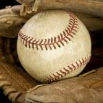 Worn leather baseball glove holding a baseball — Stock Photo