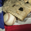 Stock Photo: Major league baseball with Americflag and glove