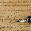 Close up of fountain pen on old letter — Stock Photo