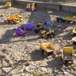 Stock Photo: Toys in sandbox