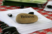 Believe stone used as paper weight — Stock Photo