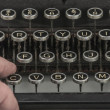 Fingers on vintage typing machine on white — Stock fotografie