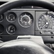 Truck dashboard through steering wheel — Stock Photo