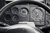 Truck dashboard through steering wheel — Stock Photo