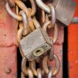 Old rusty metal padlocks on chains — Stock Photo