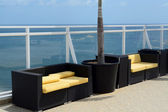 Nice firniture on a deck looking into the ocean — Stock Photo