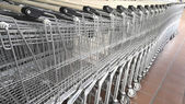Supermarket carts parked outside the building — Stock Photo
