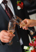 Bride and groom a clink glasses. Wedding couple — Stock Photo