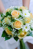 Beauty wedding bouquet of yellow roses and white camomile — Stock Photo