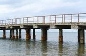 Deserted old bridge. rusty and unusable. ferroconcrete construct — Stock Photo