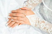 Bride holding the hands on a white wedding dress — Stock Photo