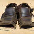 Two sandals to sprinkle with sands. Heat summer background — Stok fotoğraf