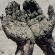 Stock Photo: Take mud cure. healthy medical procedure. dirty hands