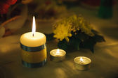 Three small candle of light. Holiday romantic ambience and decor — Stock Photo