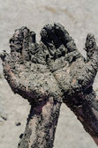 Take a mud cure. healthy medical procedure. dirty hands — Stock Photo
