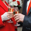 Stock Photo: Newly married couple holding wine glass in hands