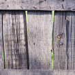 Stock Photo: Old shabby wooden fence. Rural abstract backgrounds