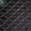 Abstract metal grid. Raw pattern — Stock Photo