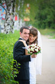 Groom and bride embrace. Love tenderness feeling — Stock Photo