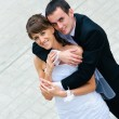 Happy wedding couple standing and embracing — Stock Photo