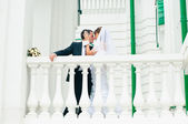 Groom embracing bride and tender touching. Love couple — Stock Photo