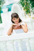 Pensive bride in white dress has leant elbows on handrail — Stock Photo