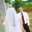 Bride and groom to look at each other — Stock Photo