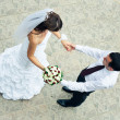 Hand in hands. top view of loving bride and groom — Stock Photo
