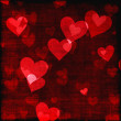 Red hearts background of Valentine's day. Love grunge texture — Stock Photo