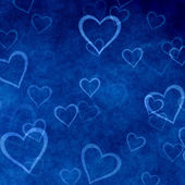 Hearts on blue background of Valentine's day. Love texture — Stock Photo