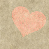 Red heart on a grunge background. Valentine's day symbol — Stock Photo
