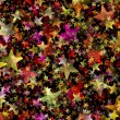 Many multicolored flying stars background. shining shapes — Stock Photo