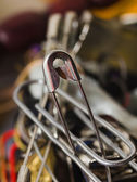 Closed safety pin on a blur backgrounds — Stock Photo