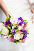 Wedding bouquet with different flowers in hands of bride — Foto de Stock