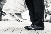 Wedding shoes in a standing and flying of couple — Stock Photo