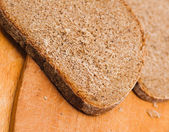 Sliced of baked brown bread — Stock Photo