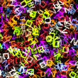 Heap of abstract multicolored flying alphabet letters — Stock Photo