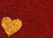 Big heart from mosaic particle on red textured background — Stock Photo