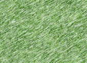 Lush green grass texture under snowfall — Stock Photo