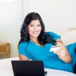 Young woman shopping online with credit card — Stock Photo #10423564