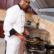 Professional chef cooking in kitchen — Stock Photo #10674520