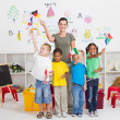 Reschool kids and teacher with flags in classroom — Stock Photo #10683258
