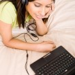 Young woman listening music — Stock Photo #11364255