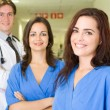 Group of young healthcare workers portrait in hospital — Stock Photo #12037244